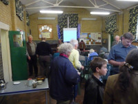 Members at an evening meeting in Dorking